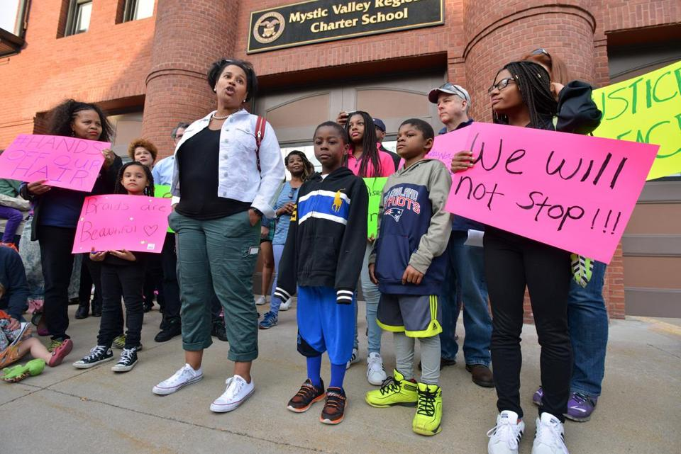 Tanisha Sullivan (center), president of the Boston NAACP, spoke during a rally outside the school in May.
