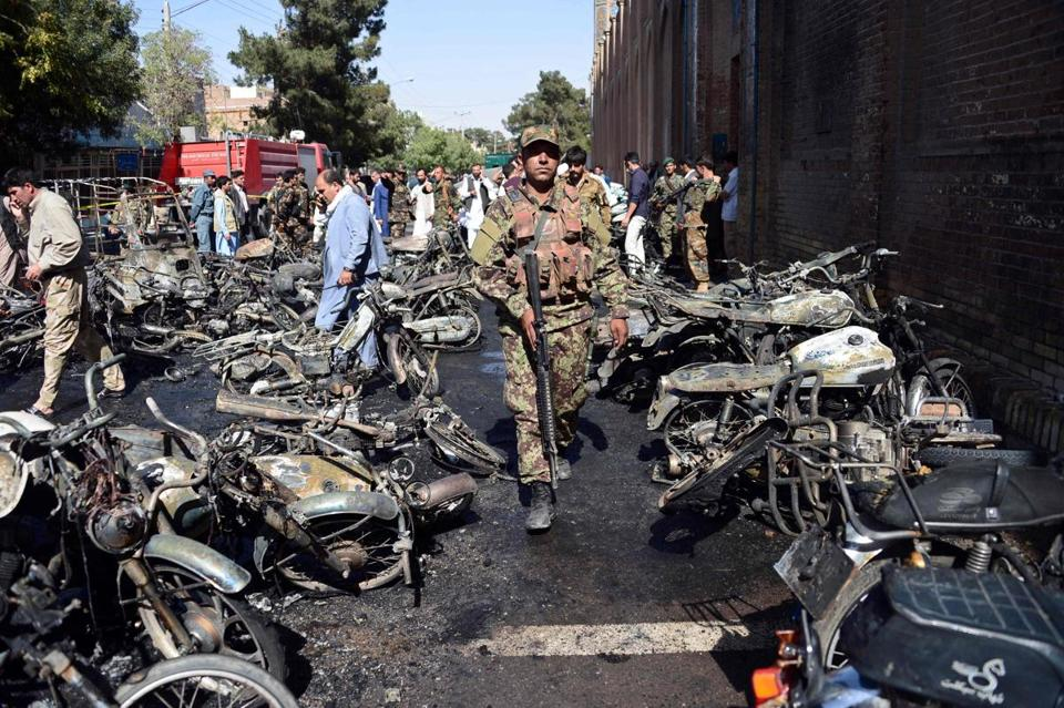 Afghan security personnel arrive at the site of a motorcycle bomb explosion in front of the Jami Mosque in Herat on June 6, 2017. A motorcycle bomb exploded near the Grand Mosque in the western city of Herat, killing seven people and wounding 16 according to the interior ministry. / AFP PHOTO / HOSHANG HASHIMIHOSHANG HASHIMI/AFP/Getty Images