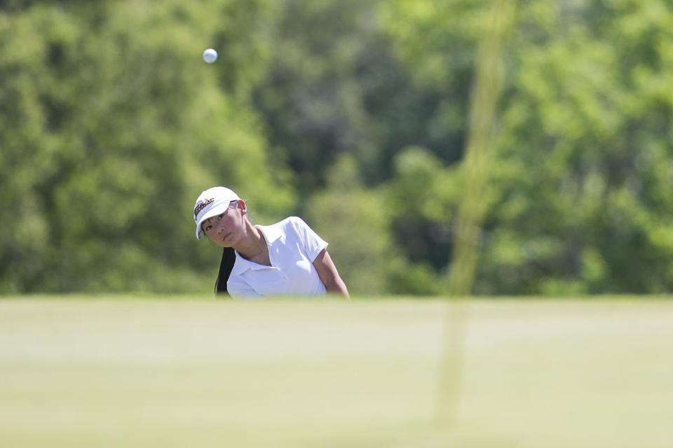 Gabrielle Shieh of Concord Carlisle High School watches her shot on to the 11th green in the MIAA girl's golf championship at Heritage Country Club in Charlton, Massachusetts on June 14, 2017. Shieh won the individual championship after an eight hole playoff against Boston Latin's Anne Walsh. Matthew Healey for The Boston Globe (SPORTS - REPORTER: Logan Mullen)