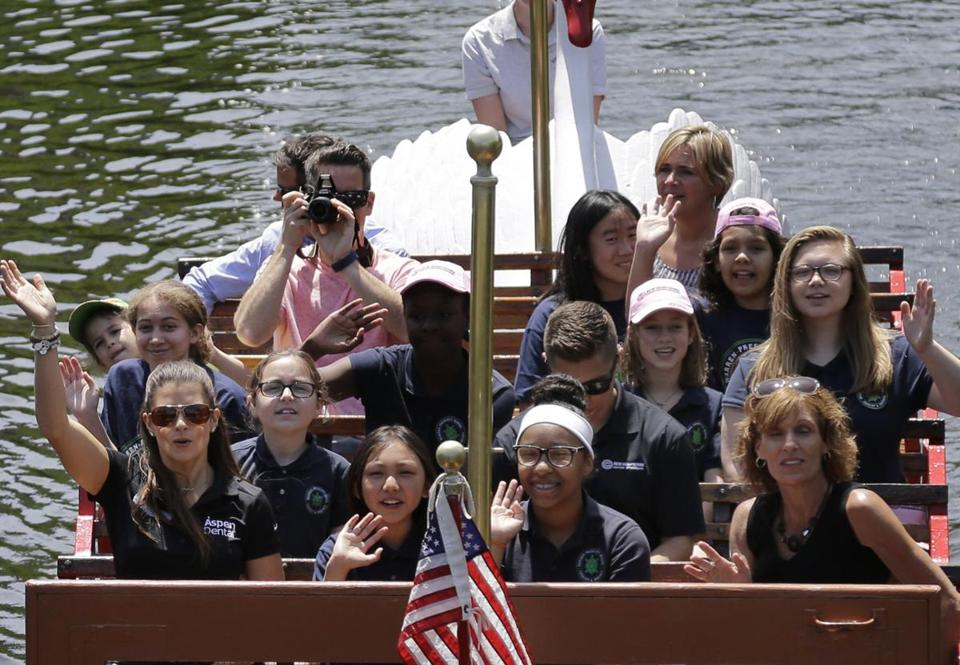 Patrick (front left) took a Swan Boat ride during her stop in Boston.