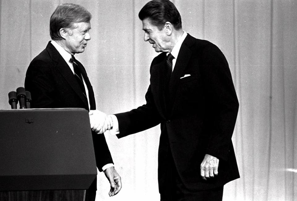 FILE--President Jimmy Carter, left, and Republican Presidential candidate Ronald Reagan, shake hands Tuesday night, Oct. 28, 1980, in Cleveland, before debating before a nationwide television audience. When Vice President Al Gore and Texas Gov. George W. Bush face each other for 90 televised minutes in Boston on Tuesday, Oct. 3, 2000, it will be the 18th time the Democratic and Republican presidential nominees have met beginning with the debate between Kennedy and Nixon. (AP Photo/stf) Library Tag 03072004 Ideas Library Tag 10032000 national foreign
