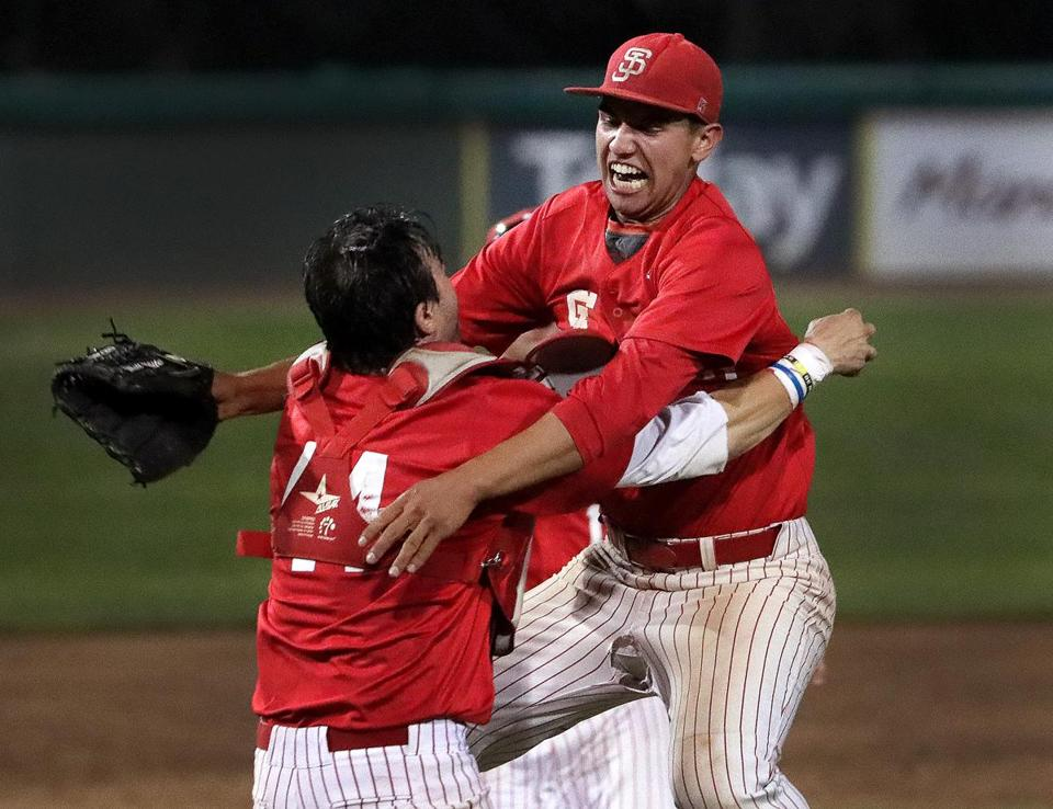Brockton, MA - 6/14/2017 - St. John's Shrewsbury pitcher Ian Seymour and catcher Jack Gardner start the celebration after defeating St. John's Prep 5-4 to win the Super 8 baseball championship at Campanelli Stadium in Brockton. - (Barry Chin/Globe Staff), Section: Sports, Reporter: James Duffy, Topic: 15super8, LOID: 8.3.2789722837.