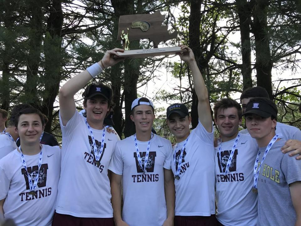 The Weston boys' tennis team celebrates its 4-1 win over Hopedale for the Division 3 state title in Shrewsbury on Thursday afternoon.