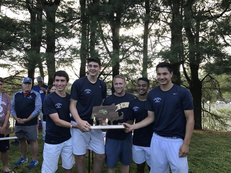 SHREWSBURY, 6/15/17 The Acton-Boxbo boys' tennis team celebrates its 4-1 win over defending champion Westborough for the Division 1 state title on Thursday at St. John's Shrewsbury