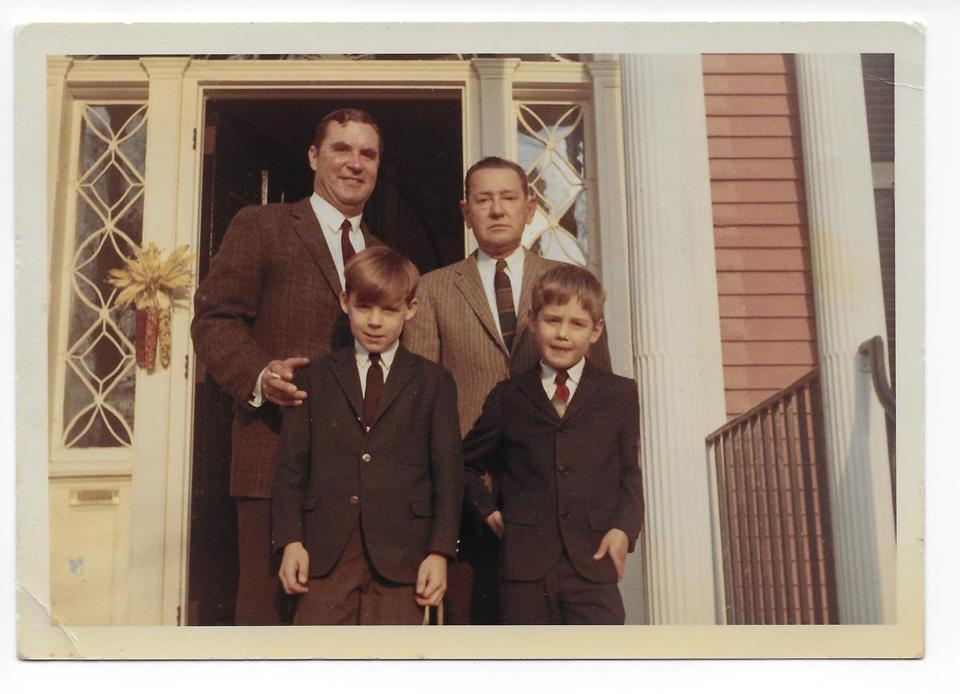 "Sturtevant ""Sturdy"" Burr (right, back row) collapsed and died in 1967 at age 57. His son, Ty (right, front row), was only 9."