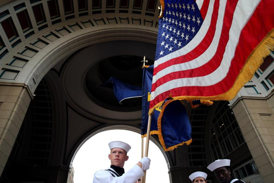 Lance Taylor of the U. S. Constitution Color Guard prepared for the Opening Ceremony of Sail Boston.