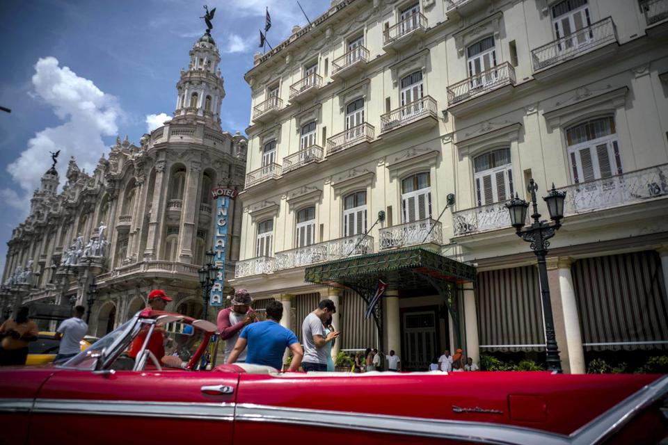 A vintage American car is parked in front of the Inglaterra hotel in Havana, Cuba, Saturday, June 17, 2017. United States President Donald Trump declared he was restoring some travel and economic restrictions on Cuba that were lifted as part of the Obama administration's historic easing.(AP Photo/Ramon Espinosa)