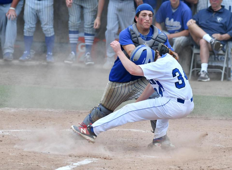 Auburn Catcher Brian Sarkisian tags Jonathan Musgrave of Dover-Sherborn (34) at the plate during the Division 3 State baseball finals at Holy Cross's Hanover Field. Josh Reynolds for The Boston Globe (Sports, duffy)