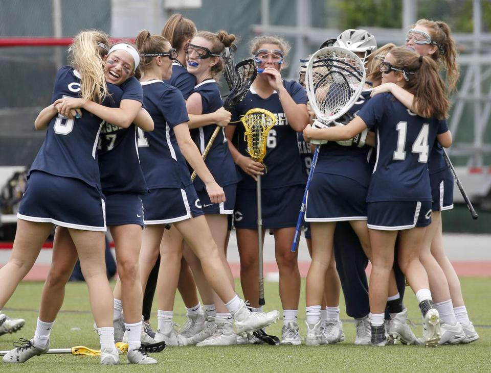 Boston, MA: 6/17/17 Cohasset players celebrate after defeating Walpole in the Division 2 MIAA lacrosse state championship game. Photo/Mary Schwalm for The Boston Globe (18hslacrosse)