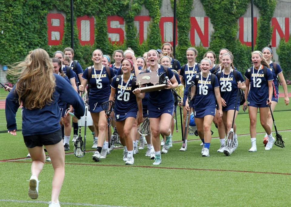 Boston, MA: 6/17/17 Needham players celebrate with the trophy after defeating Longmeadow in the Division 1 MIAA lacrosse state championship game. Photo/Mary Schwalm for The Boston Globe (18hslacrosse)