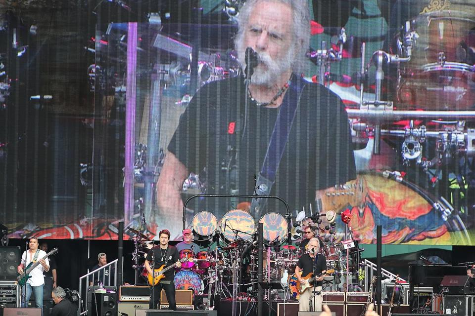 Boston MA 6/17/17 Dead & Company (l to r) Oteil Burbridge (bass/drums),John Mayer (guitar), Bill Kreutzmann (drums), Mickey Hart (drums), and Bob Weir (guitar) also on the video screen in concert at Fenway Park. (Matthew J. Lee/Globe staff) topic: reporter: