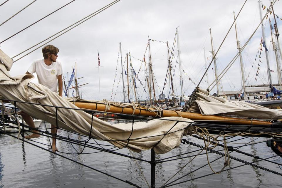 Boston, MA - 6/18/2017 - Crew member Grey Meyer of the tall ship Lynx of Portsmouth, NH unfurls a sail as visitors take public tours of tall ships as part of the Sail Boston event on Fan Pier in Boston, MA, June 18, 2017. (Keith Bedford/Globe Staff)
