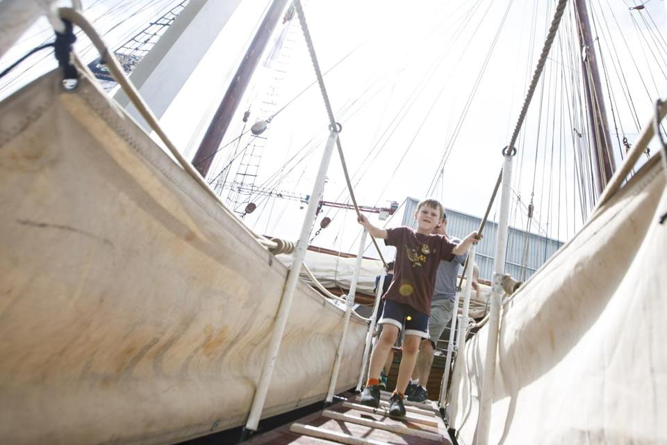 Boston, MA - 6/18/2017 - A boy walks down the gang plank of the tall ship Oosterschelde of the Netherlands during public tours of ships that are taking part of the Sail Boston event on Fan Pier in Boston, MA, June 18, 2017. (Keith Bedford/Globe Staff)