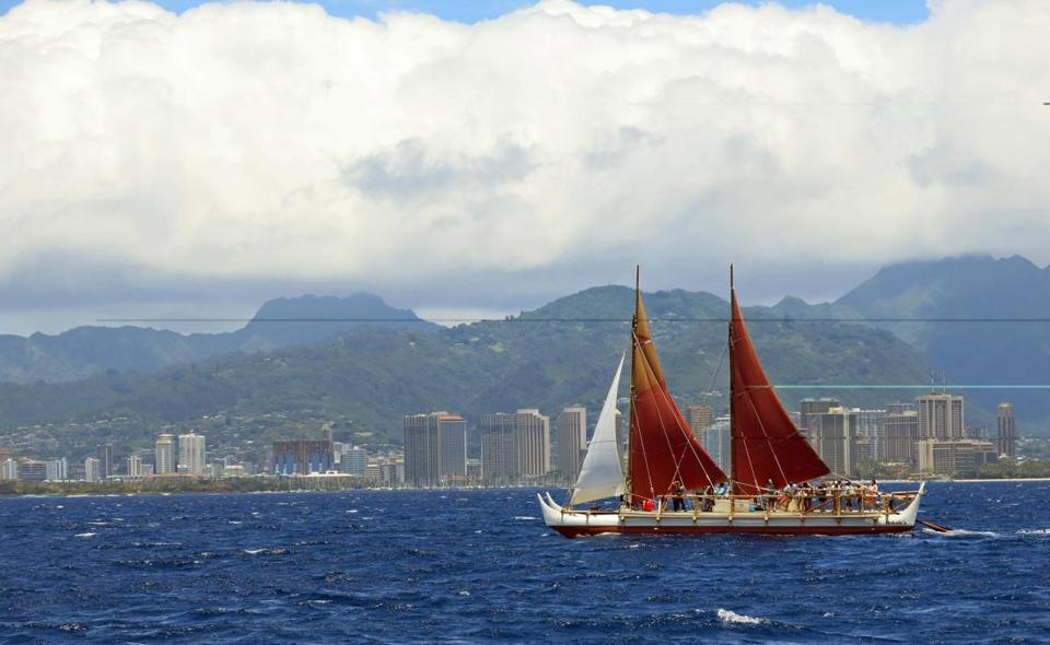 The Hokulea, a double-hulled voyaging canoe, shown off Honolulu three years ago, has returned to Hawaii after making a journey around the world.