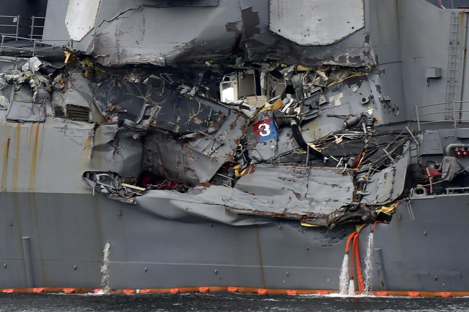 Damage to the guided missile destroyer USS Fitzgerald is seen as the vessel is berthed at its mother port in Yokosuka, southwest of Tokyo, on June 18, 2017. The bodies of US sailors missing after their destroyer collided with a container ship off Japan have been found in flooded sleeping berths, a day after the accident tore a huge gash in the warship's side, the US Navy said on June 18. / AFP PHOTO / Kazuhiro NOGIKAZUHIRO NOGI/AFP/Getty Images
