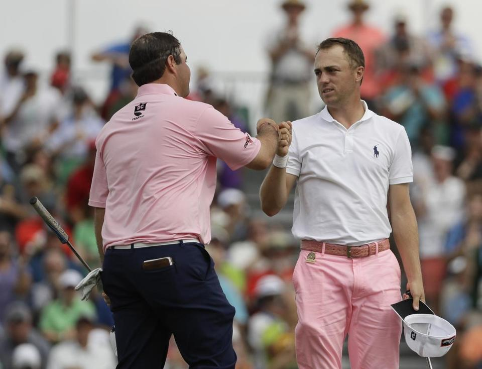 Jonathan Randolph congratulates Justin Thomas after Thomas' eagle on the 18th hole during the third round of the U.S. Open golf tournament Saturday, June 17, 2017, at Erin Hills in Erin, Wis. (AP Photo/David J. Phillip)