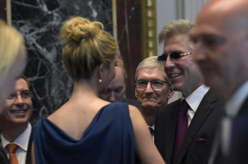 Ivanka Trump talked with Bill McDermott, head of the software maker SAP, at the opening session of a White House meeting on technology. Tim Cook. the CEO of Apple, is at center.