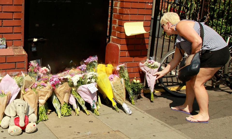 Members of the public placed flowers in Finsbury Park.