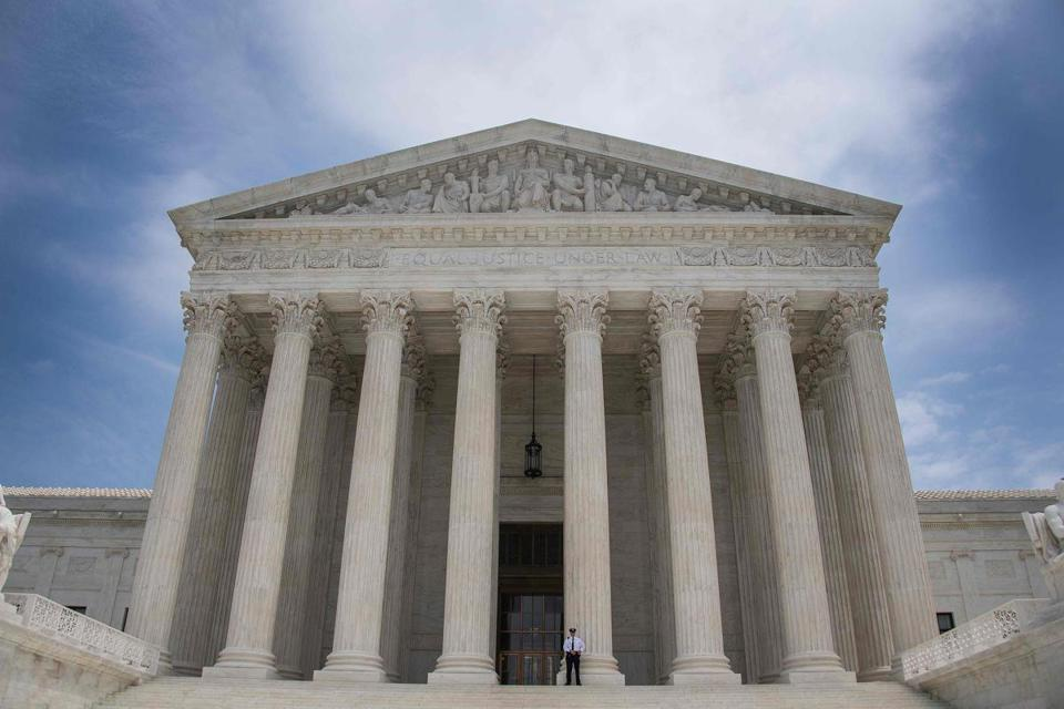 A police officer stood guard on the steps of the US Supreme Court.