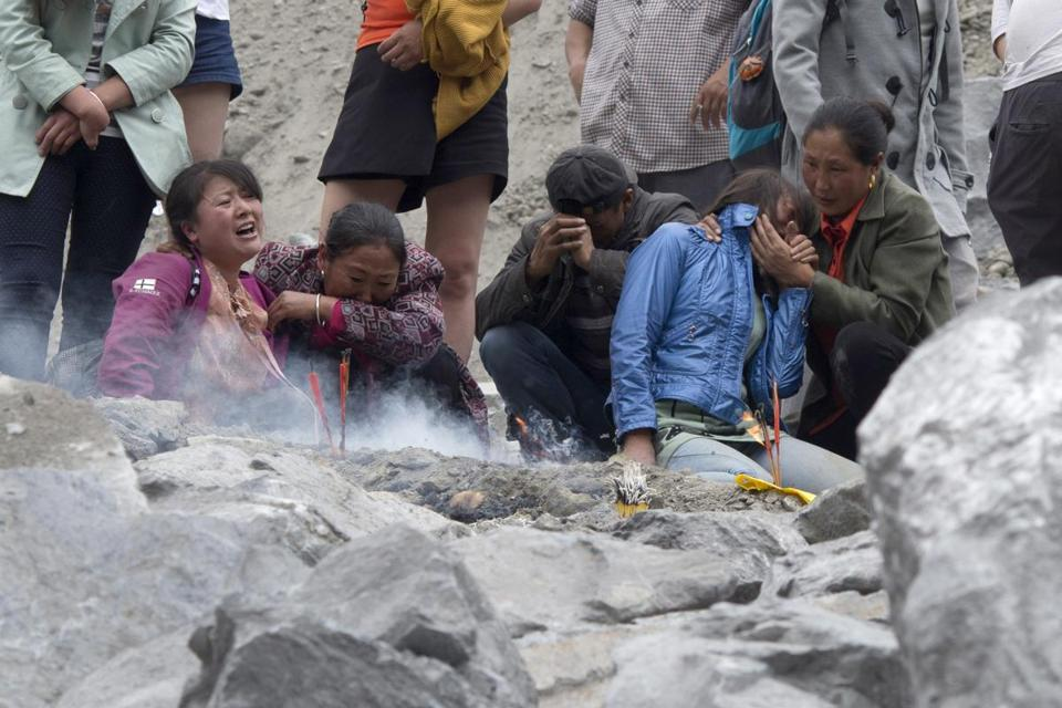 People grieved on Sunday at the site of a landslide in China's Sichuan Province.