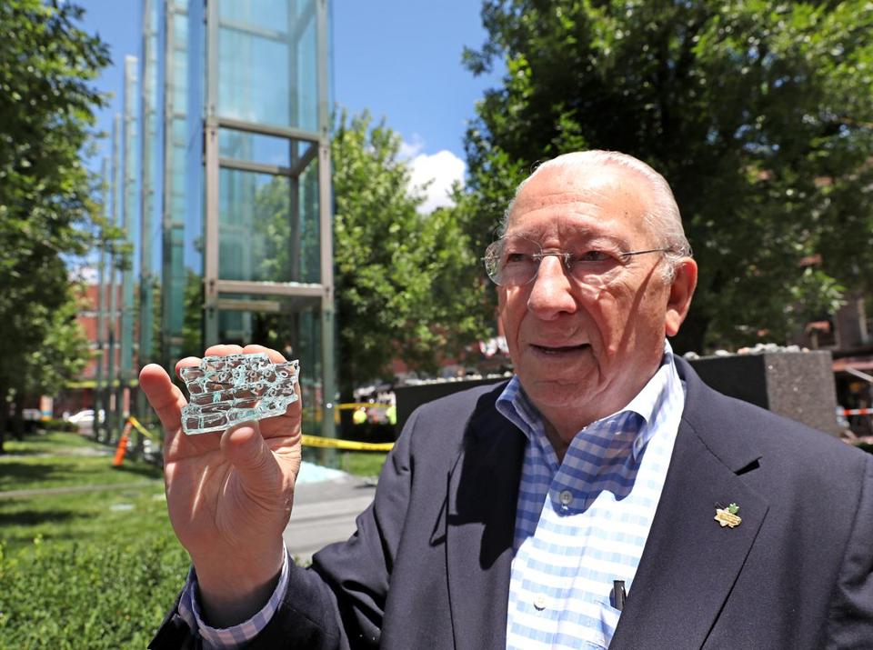 BOSTON, MA - 6/28/2017: Holding a piece of the broken glass is Israel Arbeiter, president of The American Association of Jewish Holocaust Survivors of Greater Boston. A plate of glass at the New England Holocaust Memorial in downtown Boston was damaged early Wednesday, destroying at least one of the 54 panes of glass etched with the numbers tatooed onto the amrs of Jews murdered in Nazi death camps. ADL and other groups held a press conf in front of memorial to blast vandalism (David L Ryan/Globe Staff ) SECTION: METRO TOPIC 29memorial