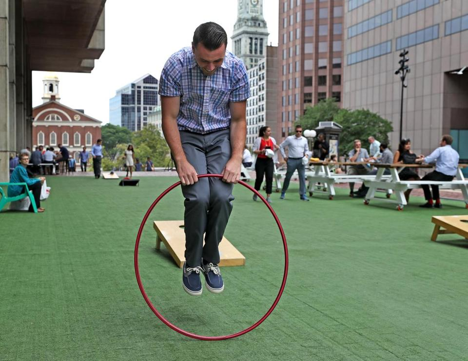 Connor Bradley jumped through a hoop during his lunch break at City Hall Plaza last week.