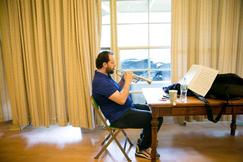 Andris Nelsons practiced the trumpet in preparation for his performance on Sunday. Nelsons relinquished the trumpet roughly 15 years ago to become a conductor in Latvia.