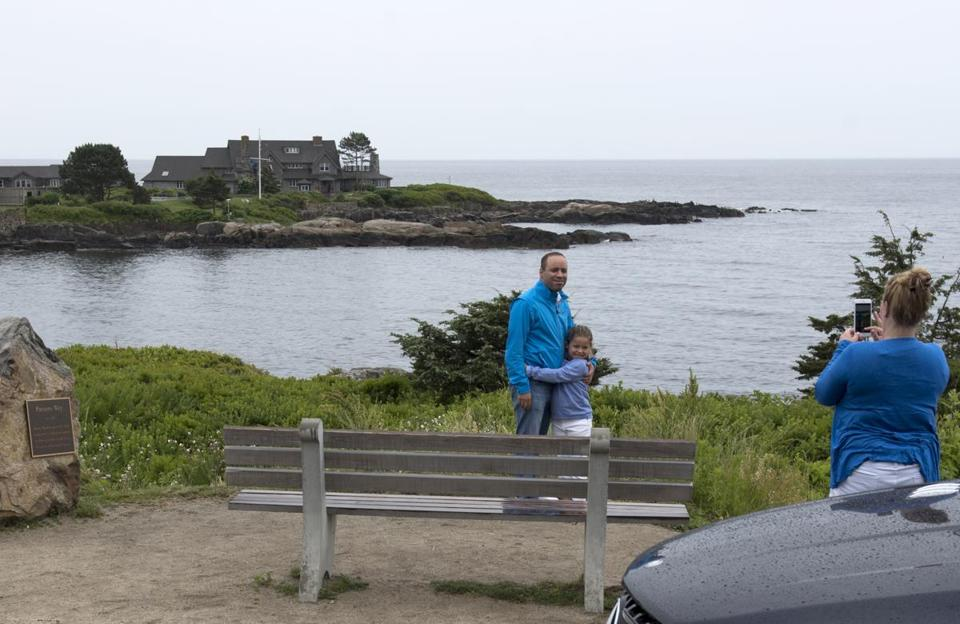 Visitors to Kennebunkport used the summer estate of George H.W. Bush, the 41st president, and his wife, Barbara Bush, as the background for their photos. Tourists often stream down Ocean Avenue to gaze at the Walker's Point residence.