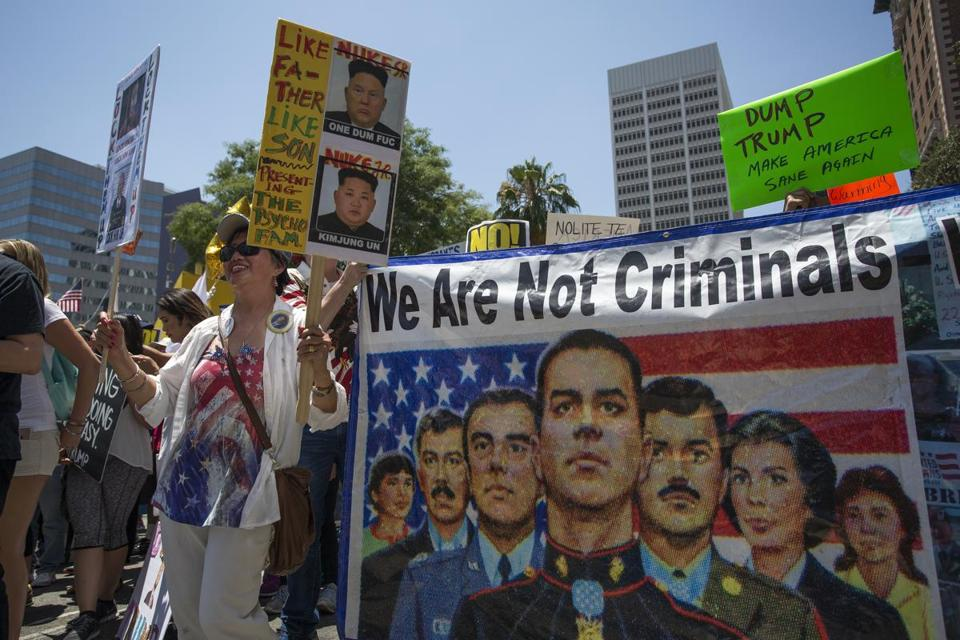 LOS ANGELES, CA - JULY 2: A banner references immigrants who serve in the U.S. military but face possible deportation during the Impeachment March on July 2, 2017 in Los Angeles, California. Impeachment March protests across the nation are calling for the impeachment of U.S. President Donald Trump. (Photo by David McNew/Getty Images)
