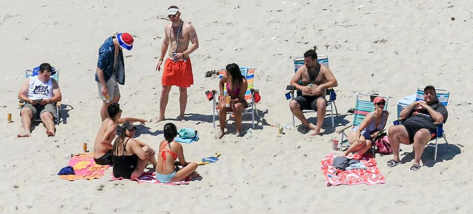 New Jersey Governor Chris Christie (right) used the beach with his family and friends at the governor's summer house at Island Beach State Park in New Jersey.