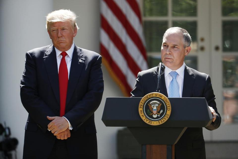 President Donald Trump listens as Environmental Protection Agency Administrator Scott Pruitt speaks about the U.S. role in the Paris climate change accord in the Rose Garden of the White House on June 1.