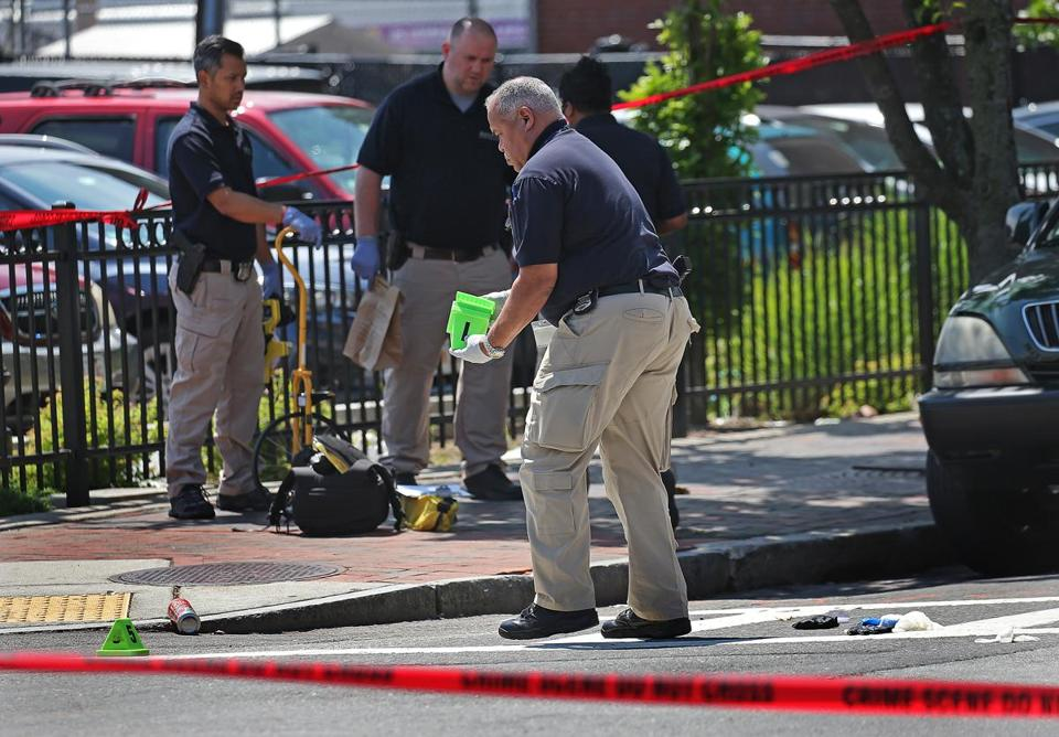 Boston police Thursday surveyed the scene at Warren Street where a man was stabbed to death.