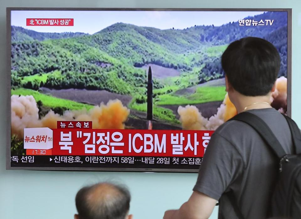 People in Seoul watched a TV newscast last week after North Korea's purported intercontinental ballistic missile launch.