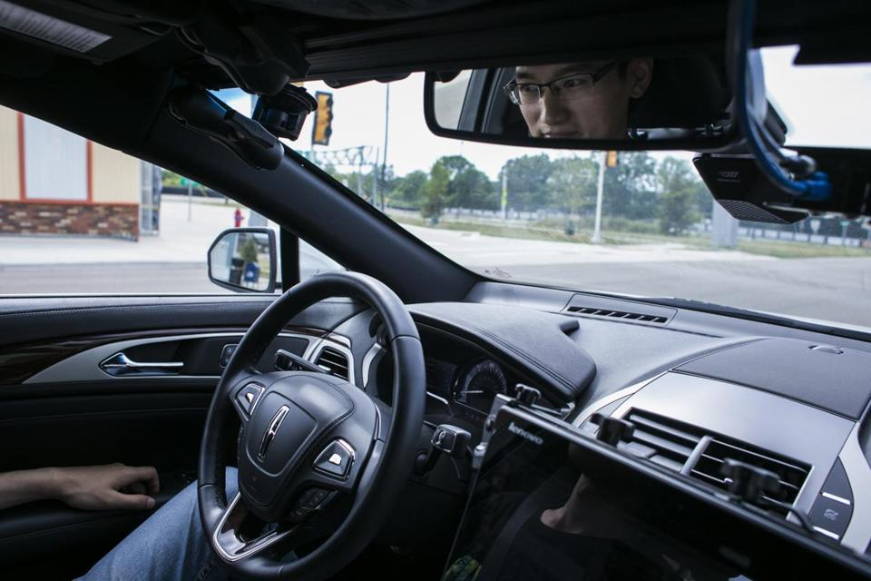 Shoabing Xu, a postdoctoral research fellow, sat in the driver's seat as a safety precaution during a demonstration of an autonomous car at the MCity testing grounds at the University of Michigan in Ann Arbor, Mich.