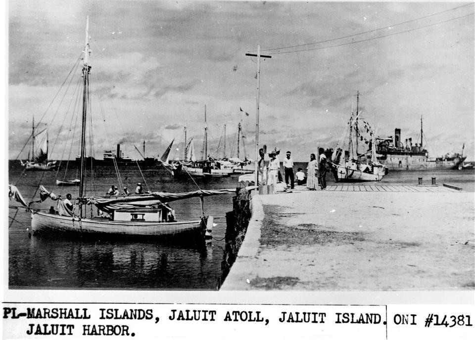 This undated photo discovered in the U.S. National Archives by Les Kinney shows people on a dock in Jaluit Atoll, Marshall Islands.