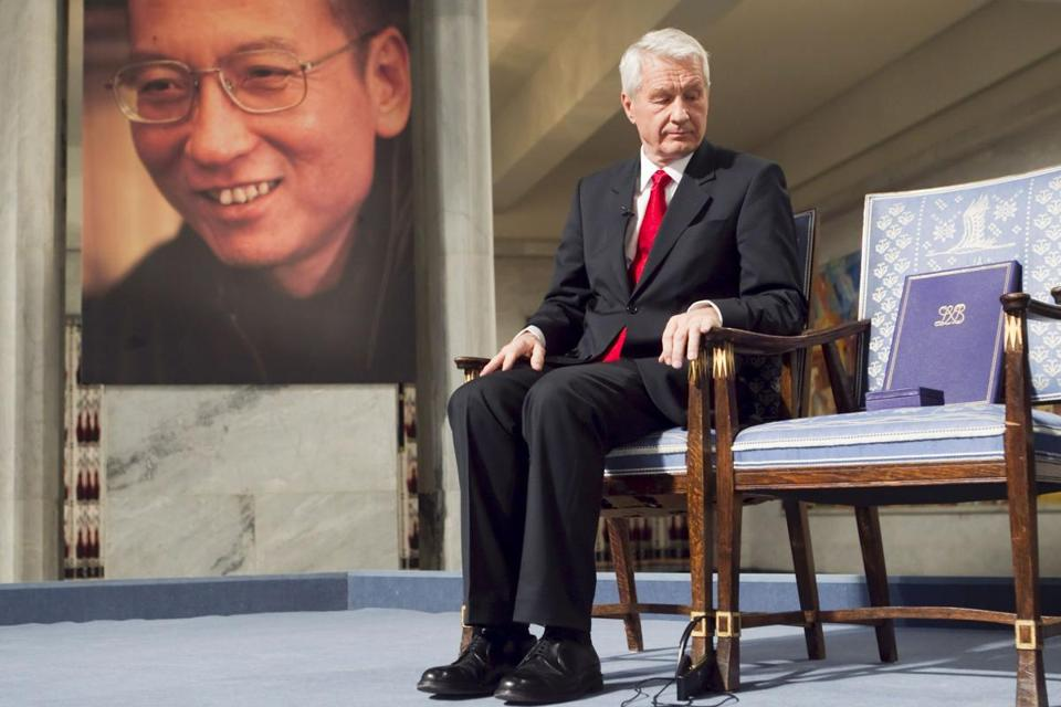 (FILES) File picture taken on December 10, 2010 shows Nobel Committee Chairman Thorbjorn Jagland sitting during the Peace Prize Ceremony in Oslo infront of a photo of Nobel peace laureate Liu Xiaobo who died July 13, 2017. / AFP PHOTO / Scanpix AND NTB Scanpix / Heiko JUNGE / Norway OUTHEIKO JUNGE/AFP/Getty Images
