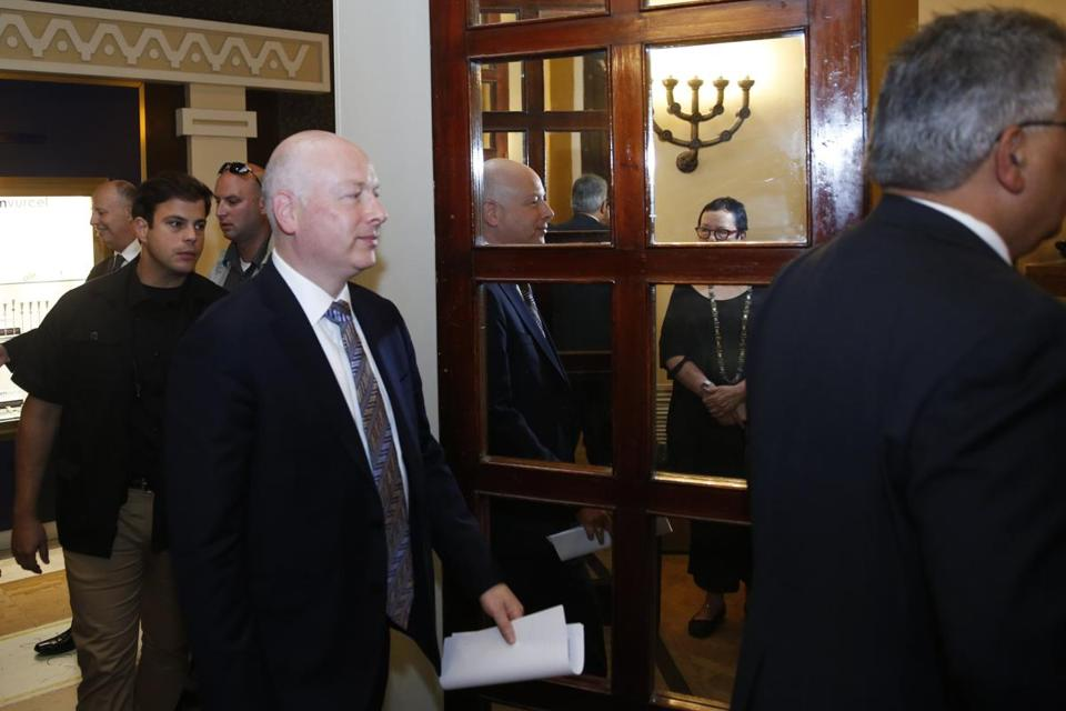 Jason Greenblatt (center), President Trump's Middle East envoy, was reflected in a mirror as he entered a room to hold a news conference in Jerusalem Thursday.