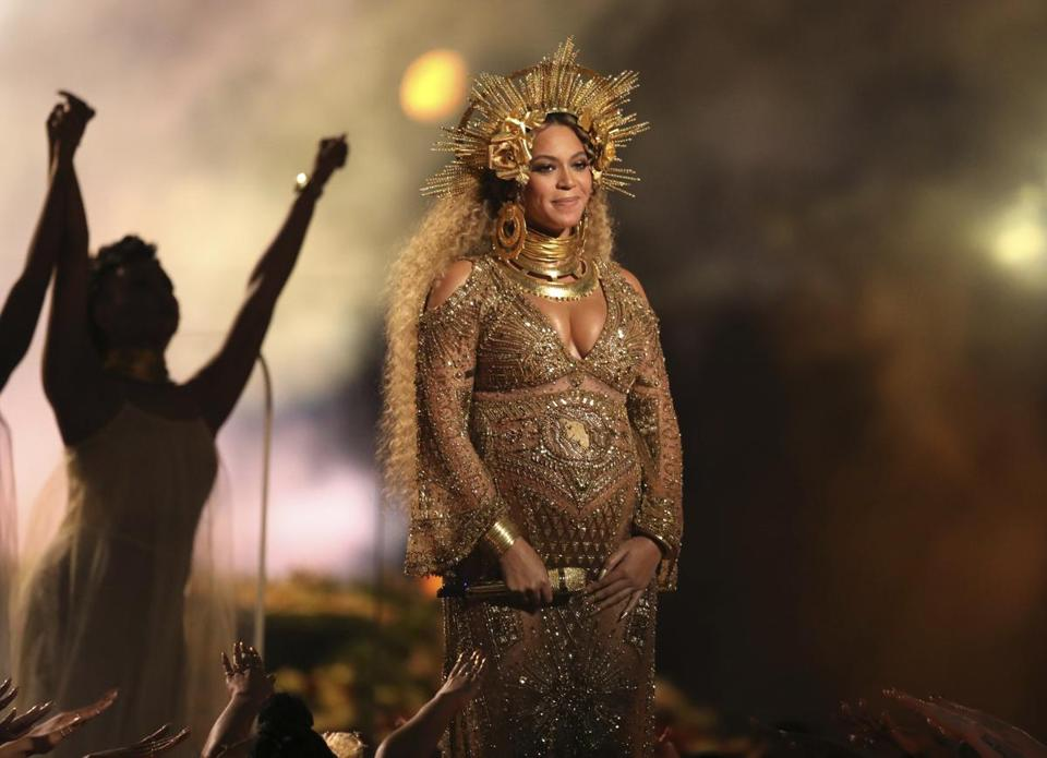 Beyonce performed at the 59th annual Grammy Awards in Los Angeles in February. The singer debuted her newborn twins Sir Carter and Rumi in an Instagram post Thursday.