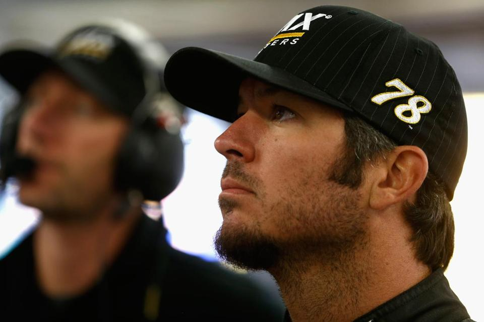LOUDON, NH - JULY 14: Martin Truex Jr. (R), driver of the #78 WIX Filters Toyota, and his crew chief Cole Pearn stand in the garage area during practice for the Monster Energy NASCAR Cup Series Overton's 301 at New Hampshire Motor Speedway on July 14, 2017 in Loudon, New Hampshire. (Photo by Jeff Zelevansky/Getty Images)