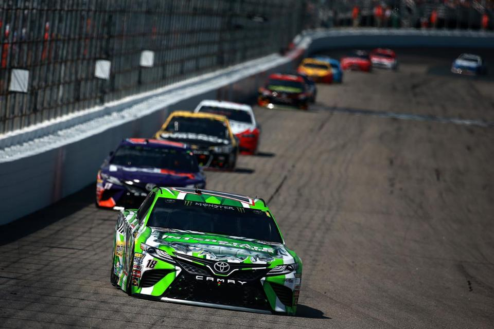 LOUDON, NH - JULY 16: Kyle Busch, driver of the #18 Interstate Batteries Toyota, leads a pack of cars during the Monster Energy NASCAR Cup Series Overton's 301 at New Hampshire Motor Speedway on July 16, 2017 in Loudon, New Hampshire. (Photo by Chris Trotman/Getty Images)