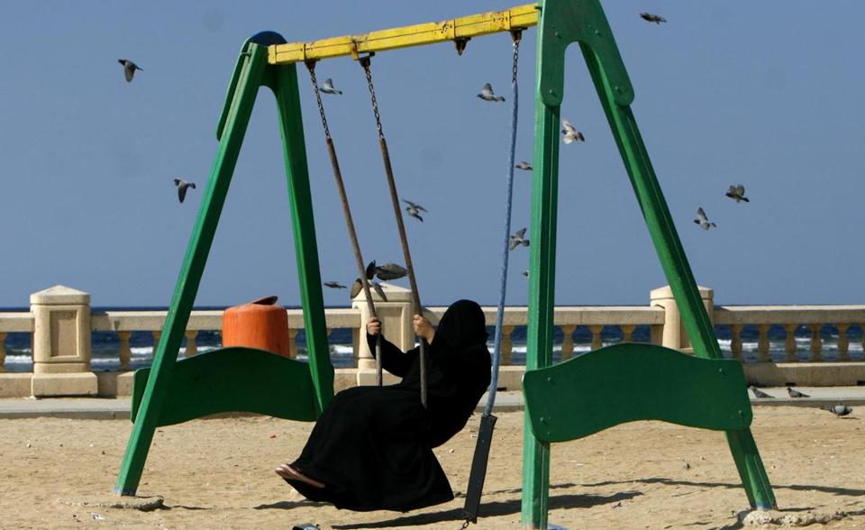 A veiled Saudi woman enjoyed a swing in a park in Jiddah, Saudi Arabia, in 2007. Women in Saudi Arabia must wear long, loose robes known as abayas in public. Most also cover their hair and face with a black veil, though exceptions are made for visiting dignitaries.
