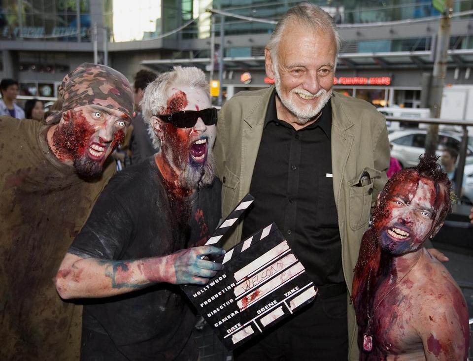 Mr. Romero posed with fans dressed as zombies at the Toronto International Film Festival in 2009.