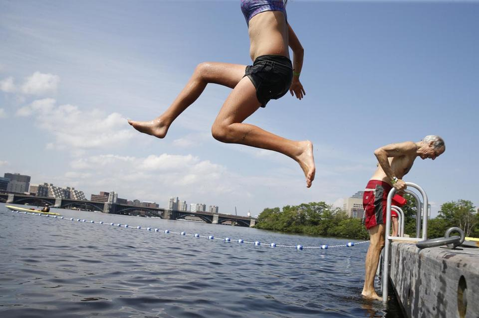 An eager swimmer leaped into the water during the sanctioned swim in the Charles hosted by the Charles River Conservancy in 2017. On Thursday, the organization announced that it won't host the swim this summer.