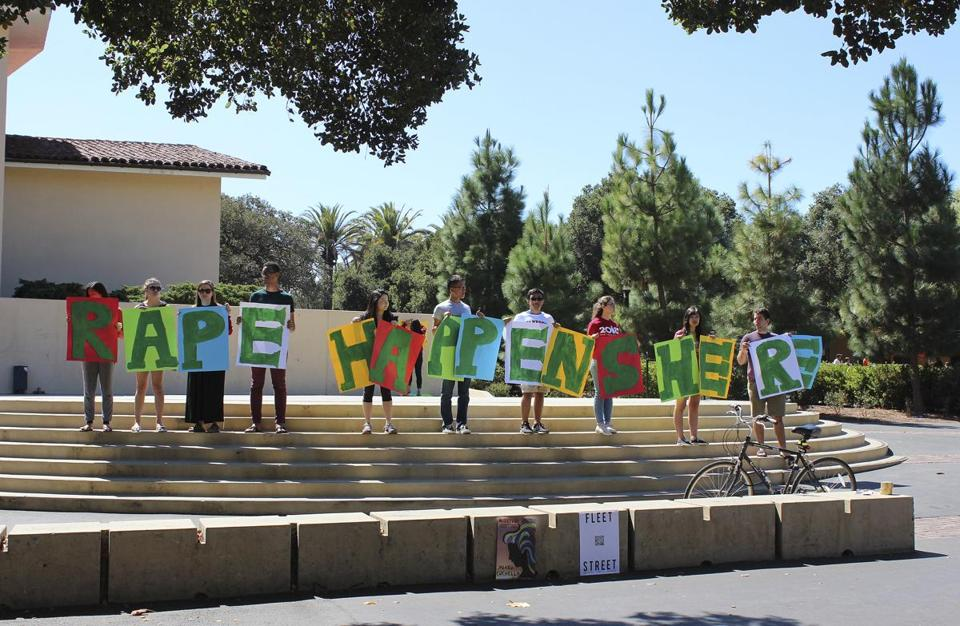 Students held up signs about rape during new student orientation in Sept. 2015 on the Stanford University campus.