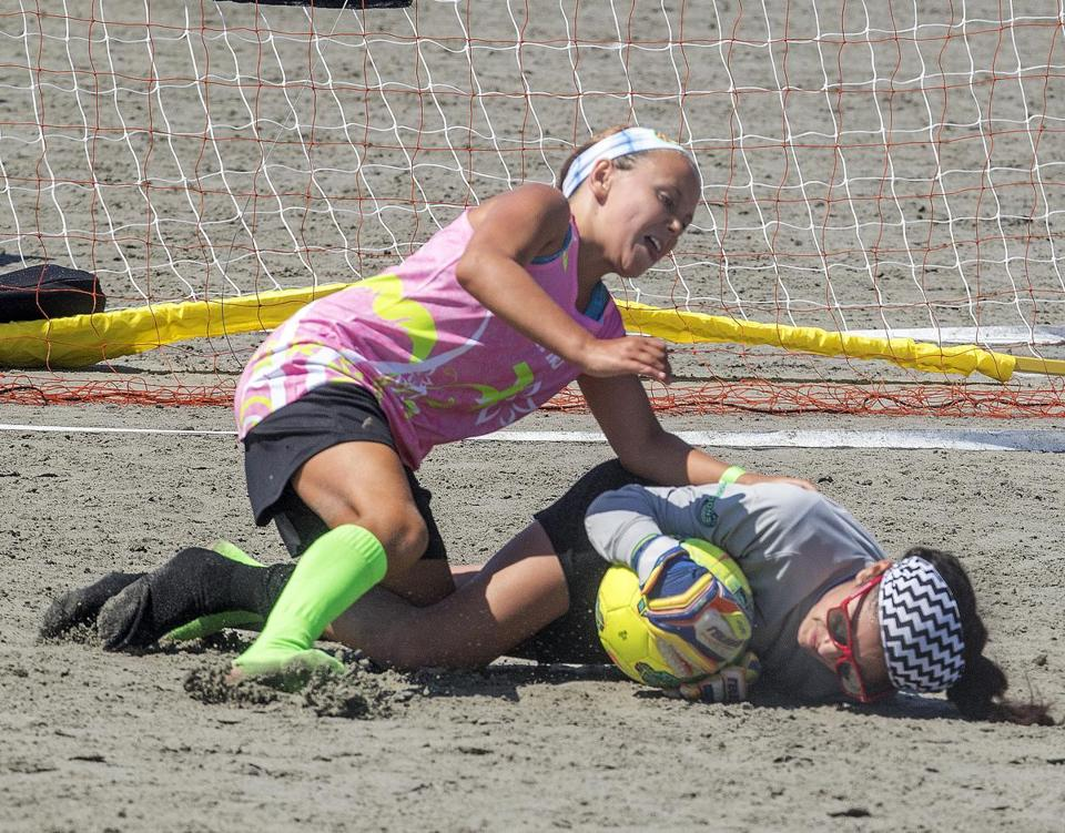 Fallon Ryan, 10, the youngest sister of Emma, looks for a rebound against goalie Adrianna Ruiz of the Boston Scorpions.