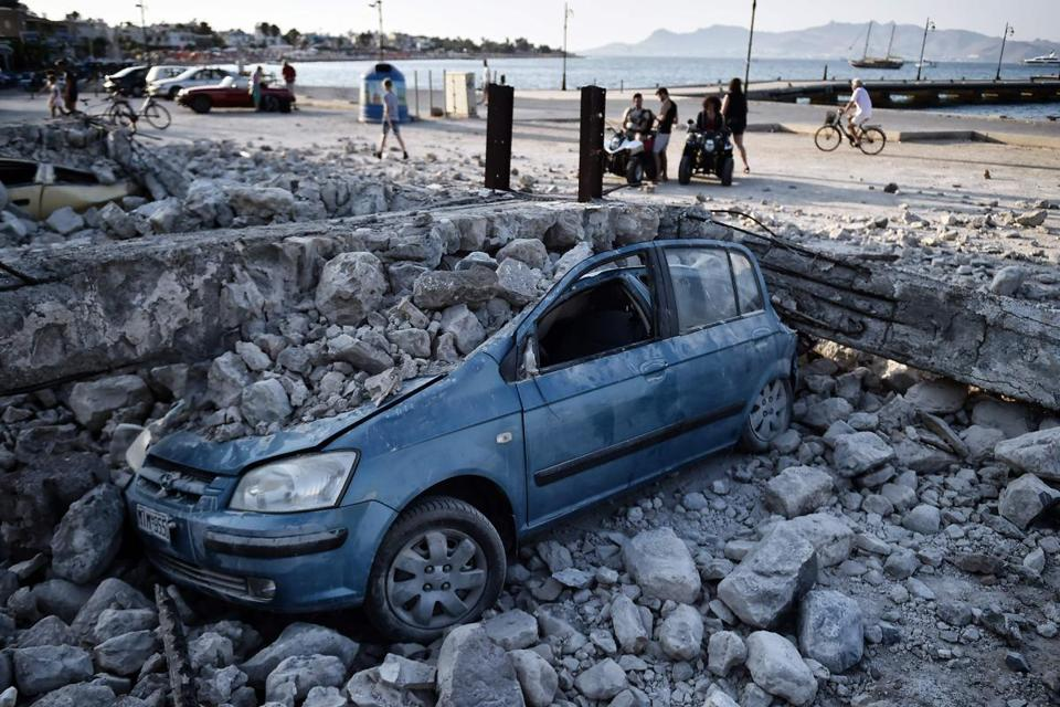 A car was crushed under rubble near the port of the Greek island of Kos after the earthquake.