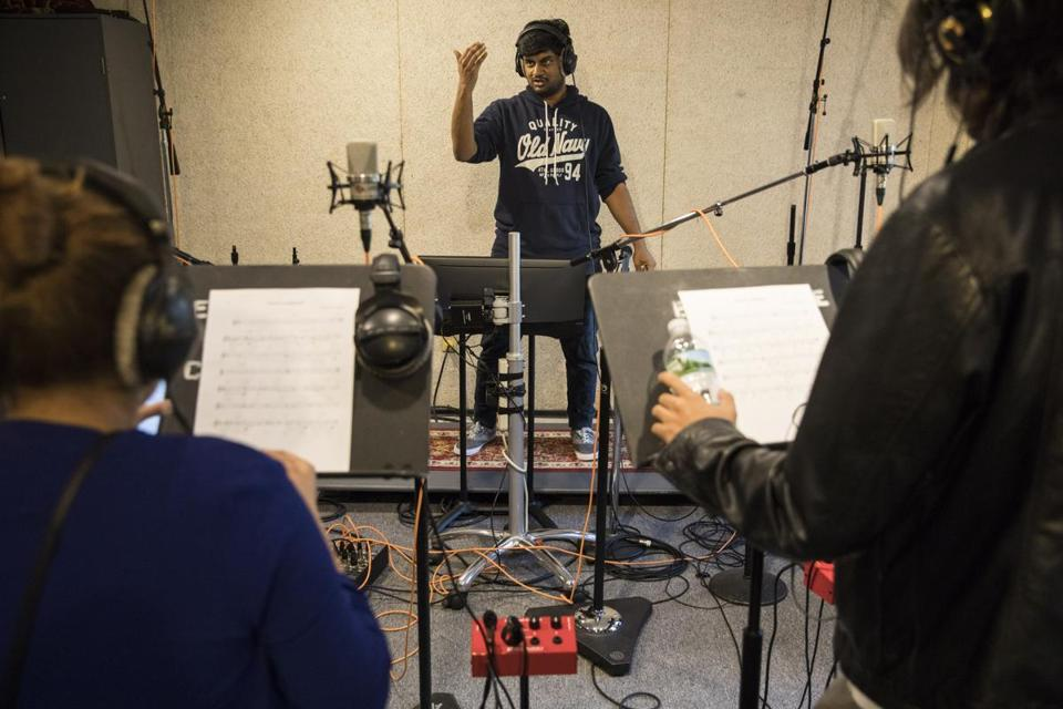 Composer Navneeth Narasimhan conducted singers during a recording session to score the music for a video game at the Berklee College of Music.