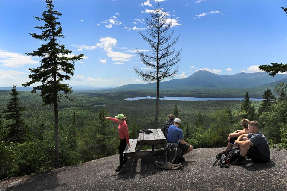 Visitors took in the view toward Mount Katahdin and Katahdin Lake from the Katahdin Woods & Waters National Monument area in northern Maine.