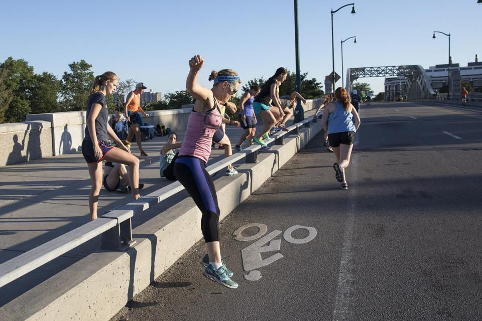 Runners from an exercise group made their way across the BU Bridge during construction on the Commonwealth Avenue Bridge.
