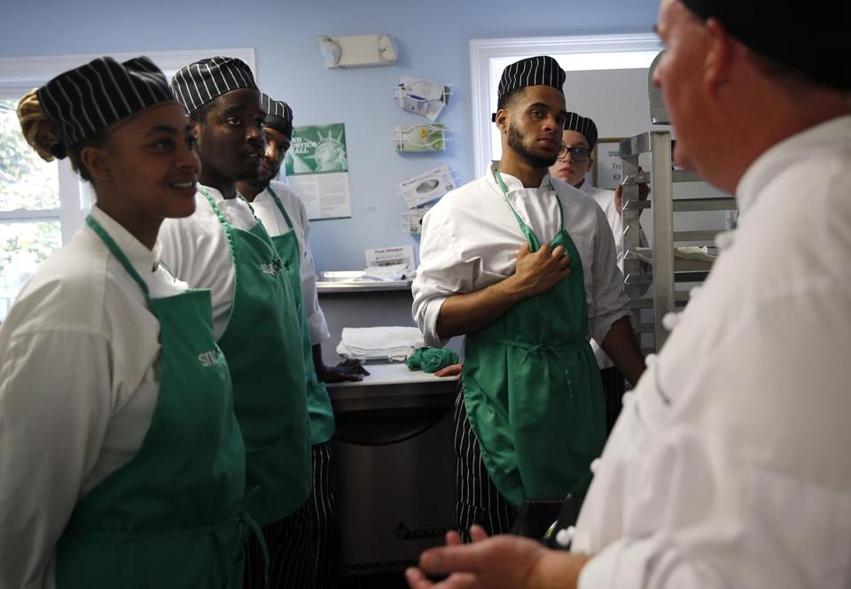 William McDonough, Director of Recruitment and Chef Instructor at Snapchef, right, spoke to his students.